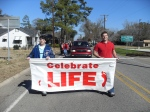 Silas and Taylor carry the banner in front of the 2011 Walk for Life.